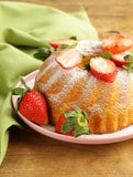 Round sponge cake with strawberries Royalty Free Stock Photo