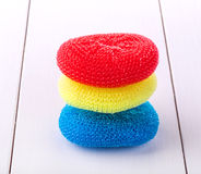 Round sponges for washing dishes in different colors royalty free stock photos