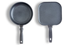 Round and square clean pans or skillets Royalty Free Stock Images