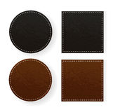 Round and square leather table coasters Royalty Free Stock Images