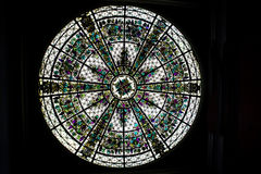 Round Stained Glass Window. A beautiful delicately designed stained glass round window in ceiling Royalty Free Stock Photos