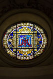 Round Stained Glass Window. With angels or cherubs and a crown in the center Royalty Free Stock Photos