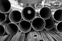 Round stainless steel tube. Stack of round stainless steel tube in factory Stock Photography