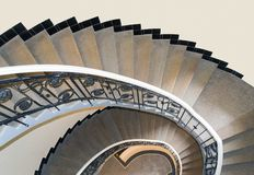 Round stairs. Viewed from above in a classic apartments building of the beginning of the twentieth century Stock Photos