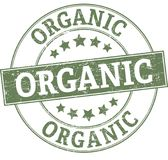 Organic round grunge green stamp. ROUND STAMP IN GRUNGY STYLE Stock Photo