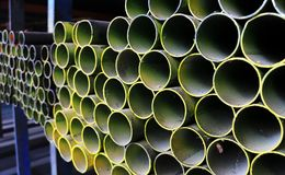 Round Steel Pipes on Shelf. For sales in the Steel Shop royalty free stock photo