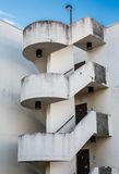 Round Steps in Parking Garage. An old grungy round staircase on a parking garage exterior Royalty Free Stock Photography