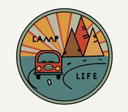 Round sticker with vintage van in retro style. Inscription Camp Life. The road, the sun in the mountains. Symbol of free stock illustration