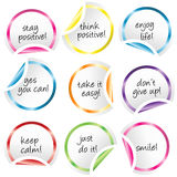 Round stickers with curled corners with positive messages Stock Image