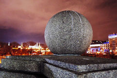Round stone ball. Color photo taken in Moscow. Moscow Kremlin is seen at background. Dramatic purple night sky Stock Photography