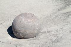 Round stone ballon white sand Royalty Free Stock Images