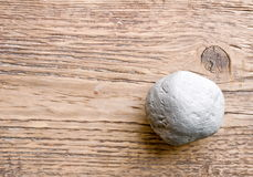 Round stone on board Royalty Free Stock Images