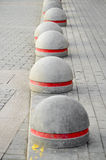 Round stone road kerb. Royalty Free Stock Image