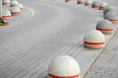 Round stone road kerb. Stock Image