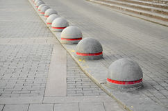 Round stone road kerb. Royalty Free Stock Photography