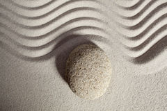 Round stone symbol in sand of zen mindset Stock Images