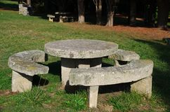 Round stone table with seats Stock Images