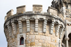 The round stone tower of the castle on the promenade in the town Stock Photography