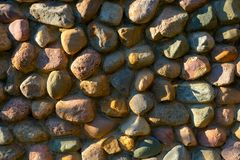 Round stone wall as a natural background or natural texture. stock photos