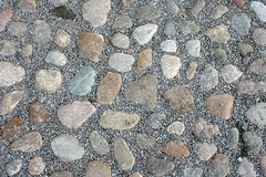 Round stones. A piece of stone pavement, background Stock Photo