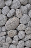 Round stones in a container Royalty Free Stock Photo