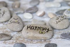 Round stones with concepts. Round stones with life philosophy concepts royalty free stock photo