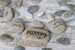 Round stones with concepts. Round stones with life philosophy concepts royalty free stock photos