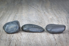 Round Stones On Wooden Texture For A Spa.