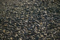 Texture of stones. Round stones texture on a beach of the French Riviera Royalty Free Stock Image