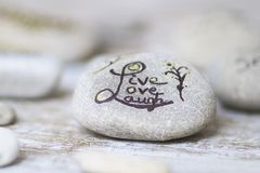 Conceptual words on stones. Round stones with wellness concepts stock image