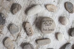 Conceptual words on stones. Round stones with wellness concepts royalty free stock photos