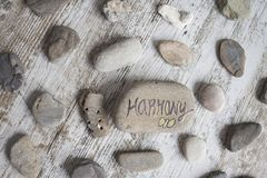 Conceptual words on stones. Round stones with wellness concepts royalty free stock image