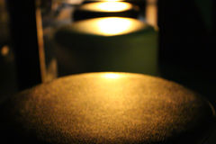 Round stool in the light. Round stool in the street lights Royalty Free Stock Photography