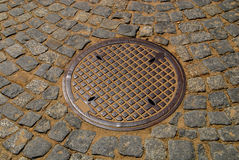 Round Storm Drain in the Road Royalty Free Stock Images