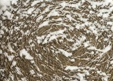 Round straw bale in snow, background royalty free stock photography