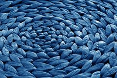 Round straw mat texture in navy blue color. Abstract background and texture for design royalty free stock image