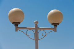 Round street lamp on blue sky background Royalty Free Stock Photo