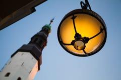 Round street lamp of Maiasmokk cafe on Pikk street Royalty Free Stock Photo