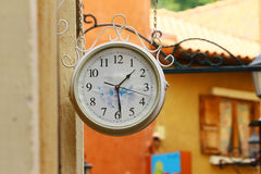 Round street watch hanging on the wall Royalty Free Stock Photography