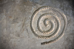 Round string prints on cement Stock Photo