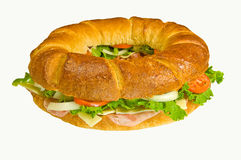 Round Sub Sandwich. Stuffed with ham, swiss cheese, lettuce, tomato, onion, and green pepper Royalty Free Stock Photography
