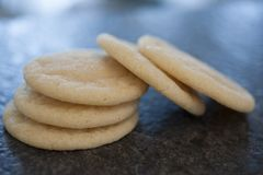 Round sugar cookies on black granite Royalty Free Stock Images