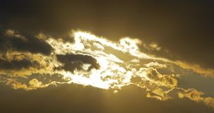 Round Sun Disc Visible Through Clouds At Sunset stock video footage