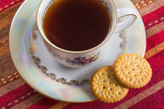 Round sweet biscuits with poppy seeds with hot tea Royalty Free Stock Photo