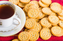 Round sweet biscuits with poppy seeds with hot tea Royalty Free Stock Photos