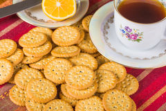 Round sweet biscuits with poppy seeds with hot tea Stock Images
