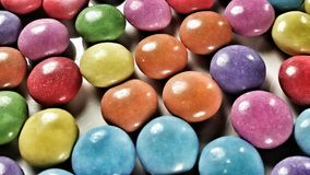 Round sweets. Closeup view of round coated sweets-chocolate Royalty Free Stock Photo