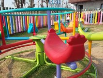 Round swings  colorful playground Stock Image