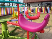 Round swings  colorful playground Royalty Free Stock Images