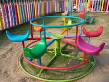 Round swings  colorful playground Stock Photos